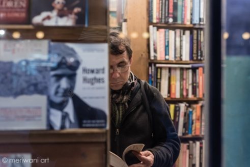 Soho, Central London, A man reading a book in a London bookshop