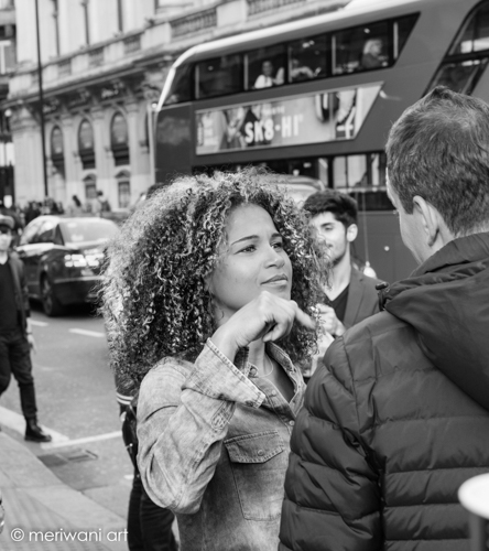 Piccadilly Circus, Central London, Couple are chatting on a busy street of London