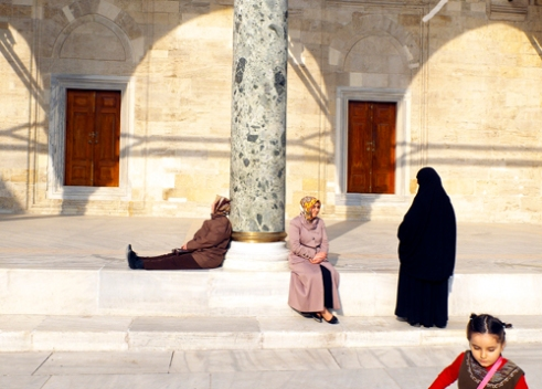 Women and child in mosque courtyard Istanbul.