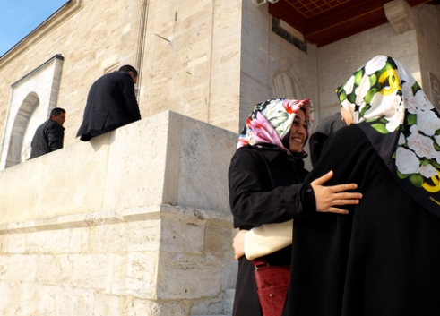 Women greet on mosque steps Istanbul