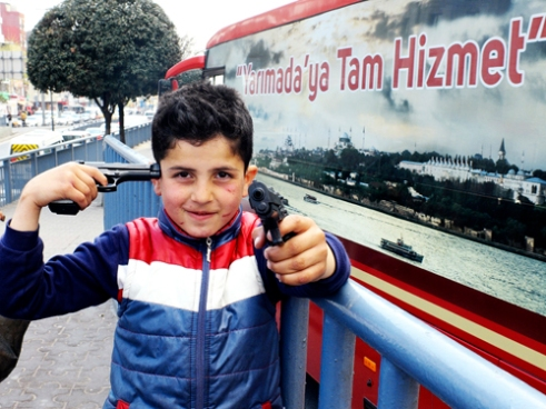 Boy with fake guns Istanbul.