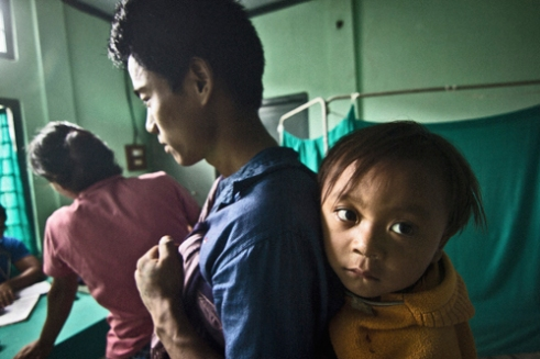 A Wancho tribal with his child in the Pongchao Primary Health Center (PHC). The PHC is 8-bedded, has one Doctor, one Nurse and serves approximately fifteen thousand people.