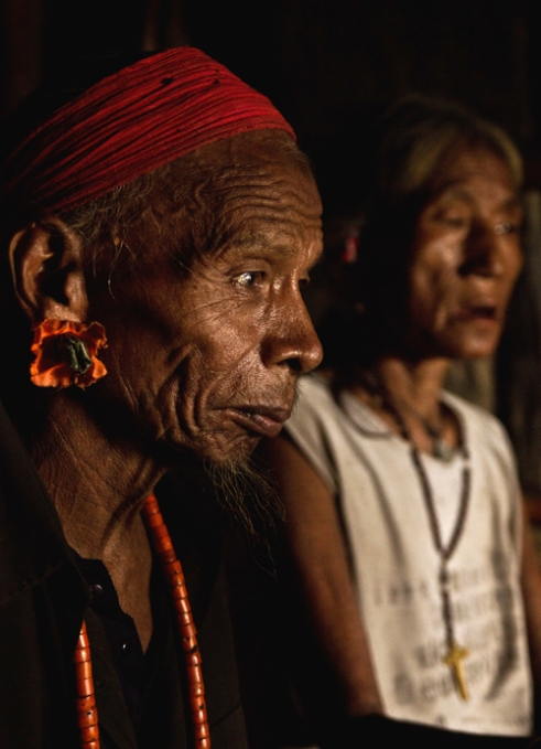 A elderly Christian couple of Wancho Tribe in their house. Conversion to Christianity is prevalent across this part of India.