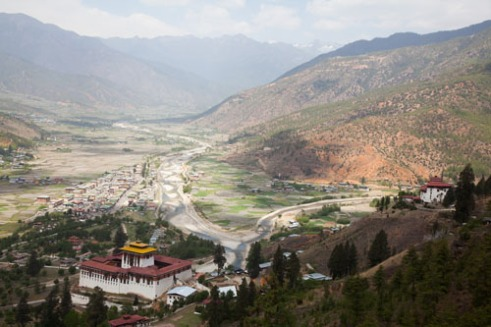 Overlooking the valley, the monastery named Paro Dzong and the small town of Paro.