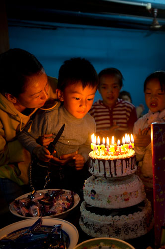 A young boy celebrates his birthday. We were the only non-Bhutanese invited to join the festivities, obviously crowned by the serving of a triple tiered birthday cake.