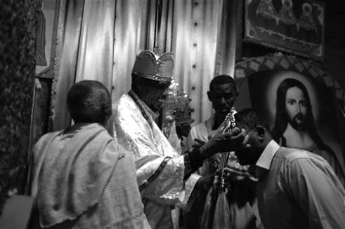 Kissing the Lalibela Cross (Afro Ayigeba)