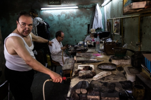 Silver craftsmen in their workshop. TUNIS