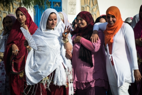 Women on the street with their typical garments during the celebrations of a wedding. DOUZ