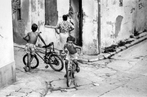Speed Two boys belonging to a Gypsy family playing on their bikes in front of their home Vilanova i la Geltru, 1990