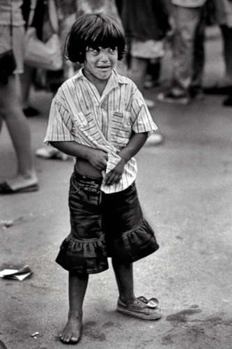 Afraid This child belonged to a gypsy balloon seller family. Sitges 1991