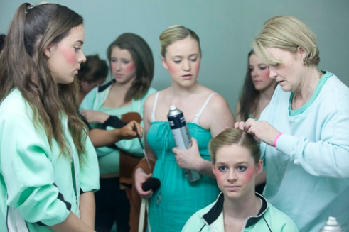 The grooming routine for 15-16 year old teams where all 8 girls are made up simultaneously and the lipstick always goes on at the last possible moment. Homebush, NSW, Australia