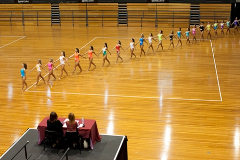 Semi-finalists march out to reveal who moves on to the next round at the qualifying heats of the 1st year Seniors, while the judges look on. State Sports Centre, Olympic Park, NSW, Australia.