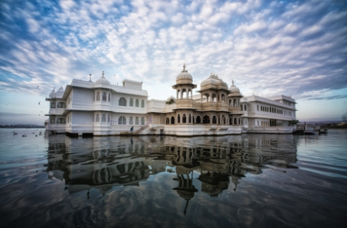 Udaipur, Rajasthan, India. Another dawn breaks over the Taj Lake Palace Hotel. The hotel looks like a fantasy liner sitting in Lake Pichola.