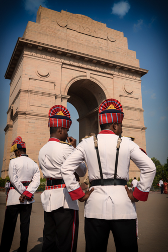 New Delhi, Rajasthan, India. India Gate. Soldiers take a rest before taking over the guard duties of the gate.