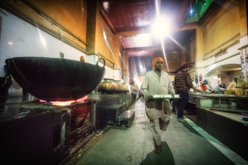 Delhi, India. Gurudwara Bangla Sahib. The food production is on an industrial scale and the kitchens are staffed by Sikh's from all backgrounds, rich and poor, who work as volunteers.
