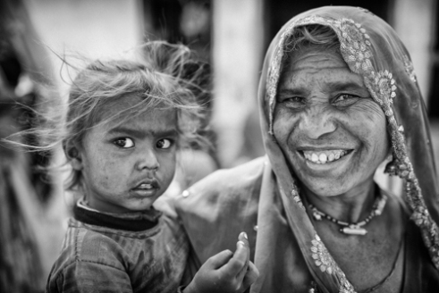 Shahpura Village, Rajasthan, India. A mother brings her daughter to say hello to us and to have her photo taken. The villagers were some of the happiest people I've ever met.