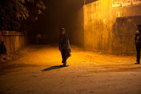 ' Night streets of Gazipur' A female garment worker walks home alone. Dhaka, Bangladesh