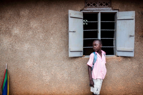 A local boy is listening to a meeting of the Makerere Women's Development Association (MAWEDA), Kampala.