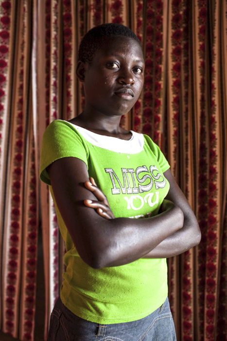 "Susan, 16, at the ""Women Won't Wait centre"" in Mubende, Uganda. After experiencing rape and violence by her father from age 11, Susan fled her home and found shelter in one of the few safe houses in the area. She tried to get her father arrested but didn't have the money for the petrol for the police car."