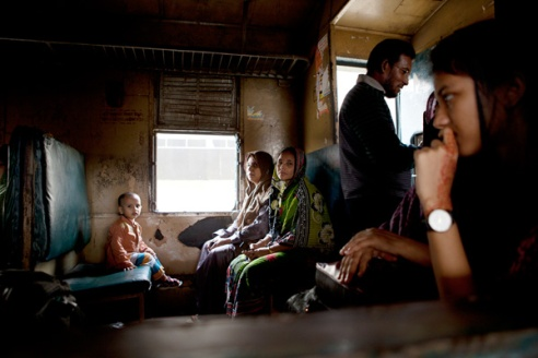 'Women and Cargo' Women will often board trains an hour before departure in order to secure a seat for them and their children. Here the sit in the one carriage reserved for women and cargo only. Dhaka main train station, Bangladesh