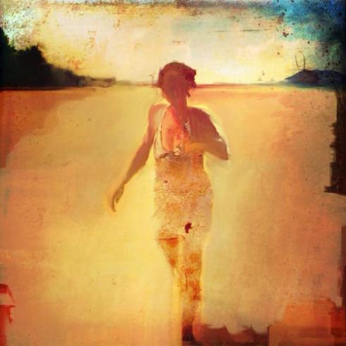 Woman At Lanakai A woman runs along the shoreline at Lanikai Beach as the sun starts to leave the sky. Lanikai, HI
