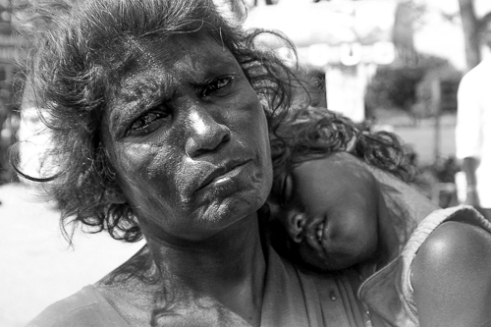 A Mother's Pain Sometimes to know a persons hardships one need only look into their eyes... A mother carries her sick child Chennai India