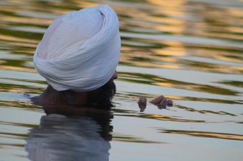 Prayer: Sikh devotee bathes and prays New Delhi, India
