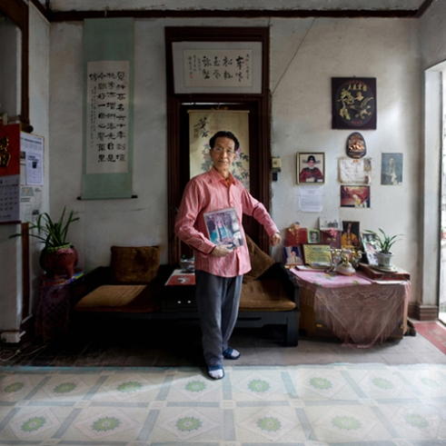 En Ning neighborhood, Guangzhou, China. 2010. Zhaobai Ye, a Cantonese opera actor. He began to learn Cantonese opera at 6. He said, from his grandfather's grandfather, his family had already acted in Cantonese opera. He made great efforts to retain and develop Cantonese opera.