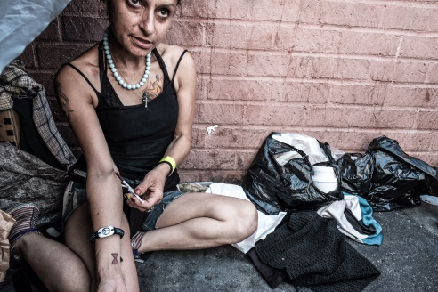 I receive a tutorial on cooking, shooting and the benefits of taking advantage of The Needle Exchange, located a few blocks away... Genevine is honest about her addiction, and thanks God each time before she injects.