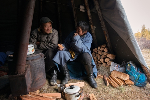 THE LIFE IN ORTZ Lkhagvasuren Battur (59), a guide, right, and Buyan-Ulzii Jargalsaikhan (39), a driver, left, relax in an ortz, the teepee-like tent made of canvas and wooden staves, in East Taiga, Mongolia on September 19, 2015.