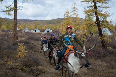 GOING TO SCHOOL ON REINDEER Ganbat Tsendee (45), far left, leaves the Tsaatan community in East Taiga, Mongolia, with his two sons, Bayandalai Ganbat (11), second left, Bayardalai Ganbat (14), second right, and Batbayar Davaadorj (14), right, to a car pickup point for a ride the rest of the way to their school in the nearest town in Tsagaan Nuur. The boys stay at the school's dormitory during the week and return to the Tsaatan camp for weekends.