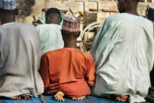 Members of Kano Polio Victims Trust Association (KPVTA) praying at their headquarters in Kano. Majority of the population in the north of Nigeria is Muslim. Kano, Nigeria