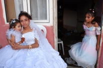 Remembering her childhood  She was 16 years old on the day of her wedding.  In her new house she hugged the little bridesmaids and cried. Maybe she thought of herself as a child like in a near past.  Tekirdag  - 2007