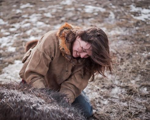 Katie field dressing a buffalo.