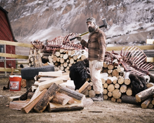 Josh chopping wood in camp.