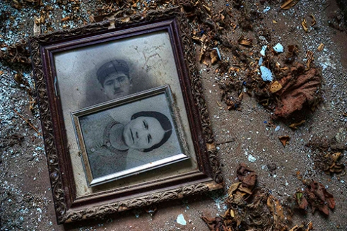 Old pictures in an abandoned house. Sikia Village, Greece.
