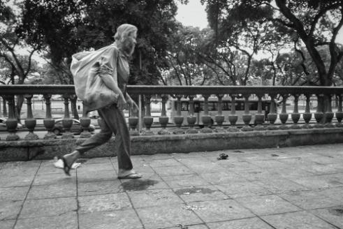Old homeless running