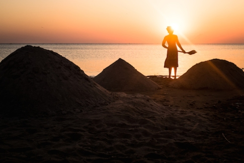 A woman mines sand for building on the shore of Lake Malawi near Nkhata Bay.