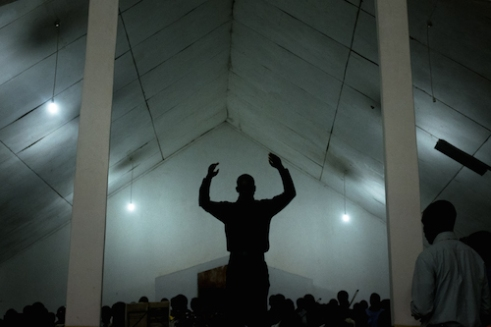 A conductor leads a choir at the Mzuzu Pentecostal Church in the town of Mzuzu, Malawi's third largest city.