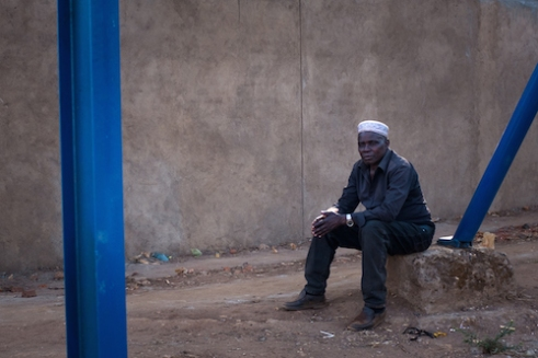 A Muslim sits on the side of the road in Lilongwe, Malawi's capital. According the Malawi Religion Project, a quarter of Malawians are Muslim.