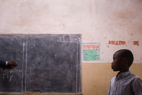 A student at Chimpeni Primary School outside Zomba stands to answer a question from the school principal.