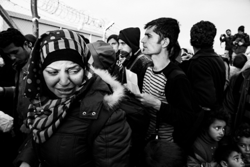 Refugees in the queue for checkpoint at the Greek- Macedonian border.