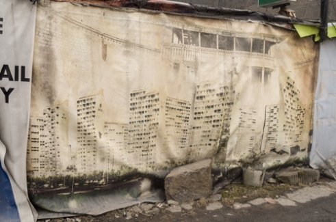 The billboard used for the promotion of high-rise apartments in the past represents the dream of many residents of Guryong village.