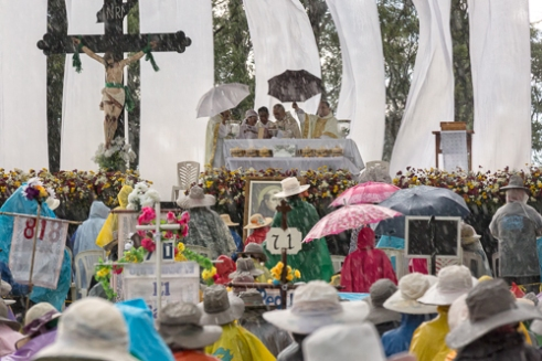 Monseñor Diego Monroy celebrating Mass during heavy rain near Tepotzotlan State of Mexico.