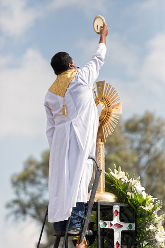 Father Bernardo Resendiz holding the Sacred Sacrament during the Holly Hour in Cuautitlan State of Mexico.