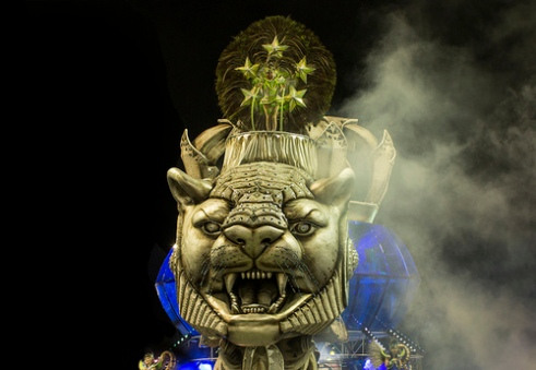 São Paulo, Brazil- February 7, 2016: Float featuring large lions head with samba dancer on top for the samba school Imperio de Casa Verde at the Amhembi Sambadrome in Sao Paulo. Carnival is an annual competition between samba schools in their respective cities. Performers will dance and sing in full costume as they parade for the judges. Sao Paulo is home to the second largest carnival celebration in Brazil.