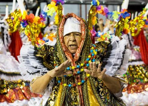 São Paulo, Brazil- February 7, 2016: Brazilian samba dancers performing in costume for the samba school Academicos do Tucuruvi at the Amhembi Sambadrome in Sao Paulo.