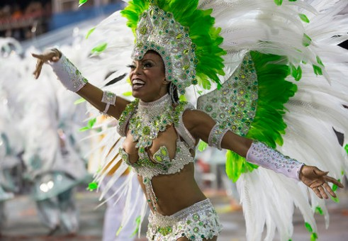 "São Paulo, Brazil- February 7, 2016: A female Brazilian samba dancer called a ""Muse"" is performing in costume for the samba school Mocidade Alegre at the Amhembi Sambadrome in Sao Paulo."