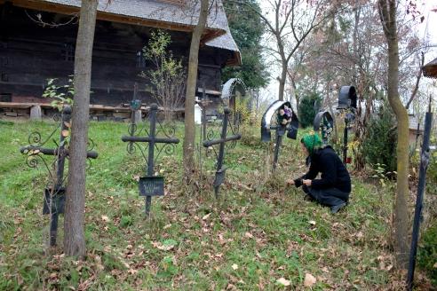 Weeding an Unfamiliar Grave