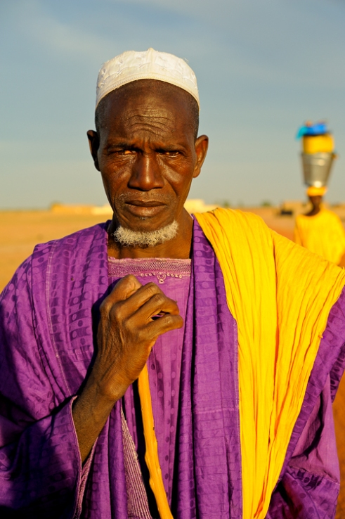 Man in Purple coming home from market. Senossa Village